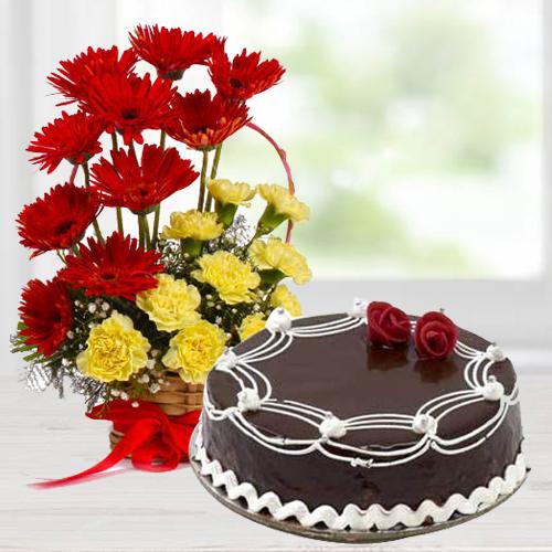Premium Carnations and Gerberas Arrangement with 1/2 Kg Dark Chocolate Cake