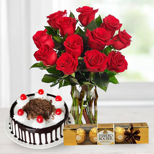 Online Bouquet of Red Roses with Ferrero Rocher and Black Forest Cake