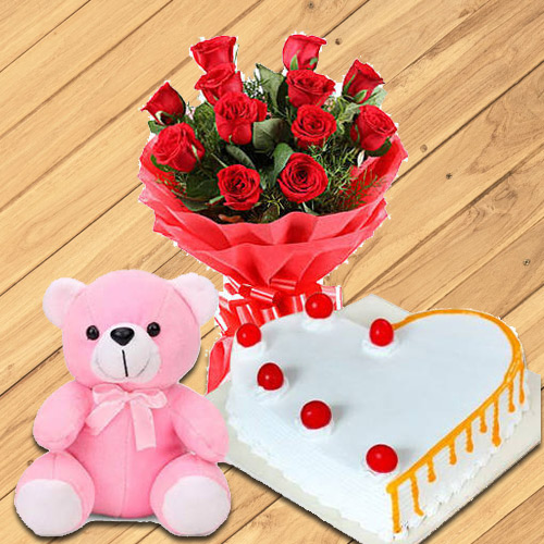 Deliver Red Roses with Teddy N Heart-Shaped Cake Online
