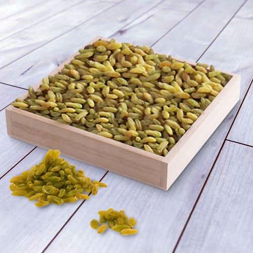 Online Raisins in a Wooden Tray