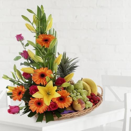 A beautifully arranged fruit and flower basket for dear mom