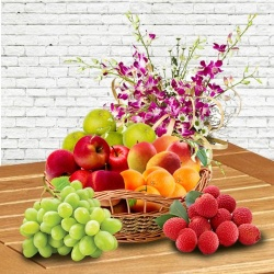 Moms Delight Fresh Fruits Basket decorated with Orchids
