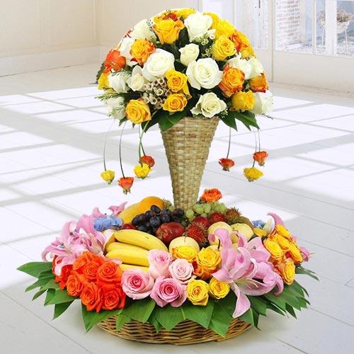 Premium Arrangement of Fresh Fruits N Flowers