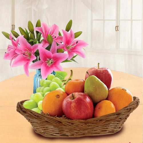 Tasty Fresh Fruits Basket with Pink Lilies