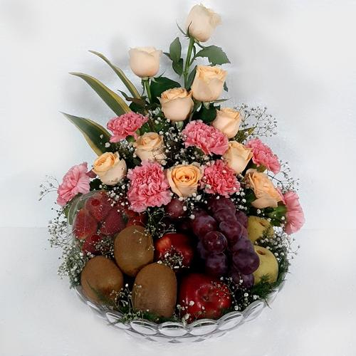 Exquisite Fruits with Orange Roses n Pink Carnations in Glass Vase