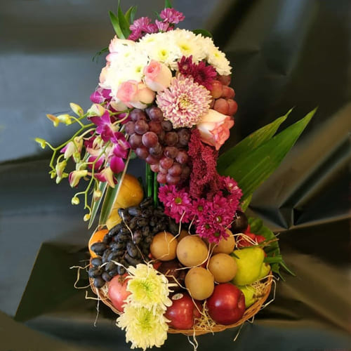 Lovely Tall Arrangement of Flowers n Fruits