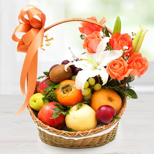 Beautiful Imported Fruits Basket with Orange Roses n White Lily
