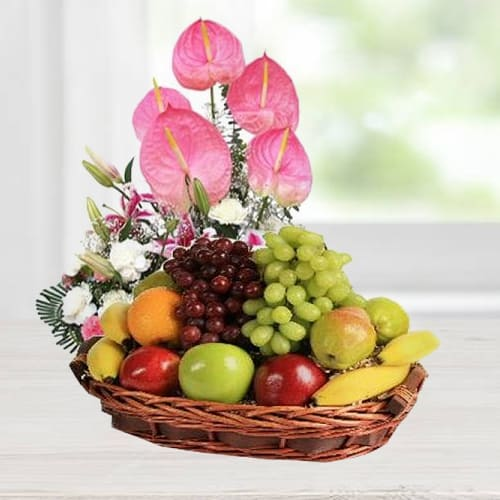 Garden-Fresh Fruits Basket designed with Anthodium, Lily n Carnations