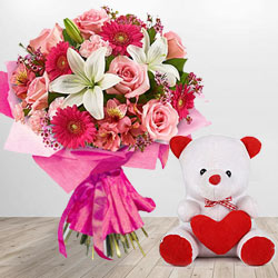 Fresh and bright Flowers and a cute Teddy Bear