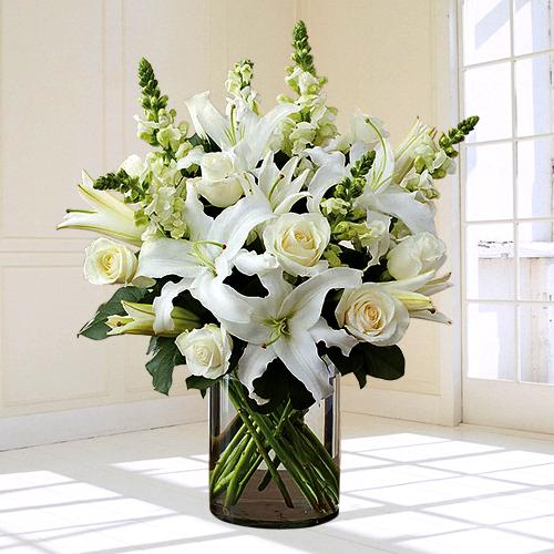 Touching White Flowers in Glass Vase for Peaceful Remembrance