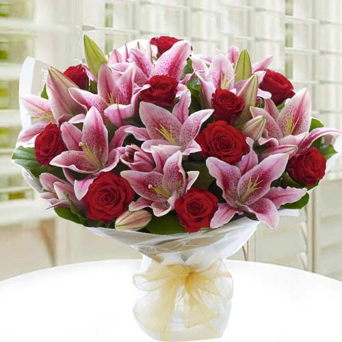 Radiant Hand Bunch of Roses & Lilies