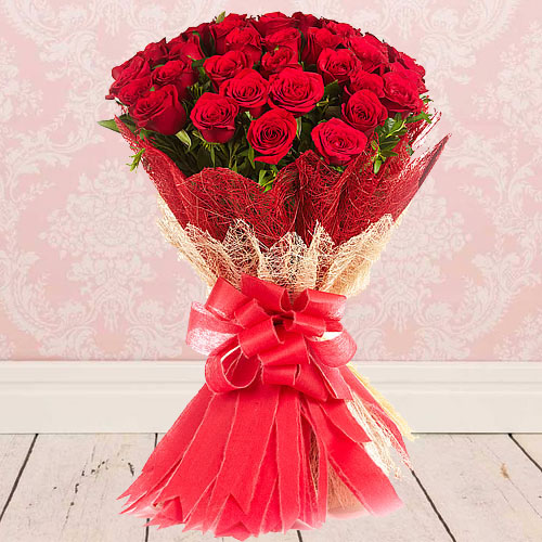 Exotic Bunch of Red Roses beautifully wrapped