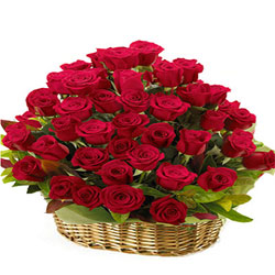 Attention-Getting Arrangement of Red Roses in Basket