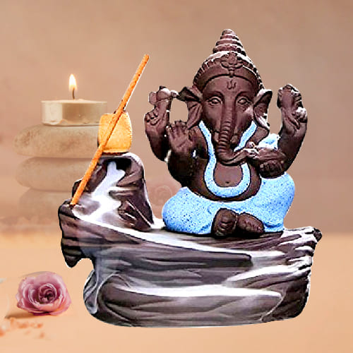 Marvelous Bal Ganesha Smoke Fountain Polyresin Showpiece