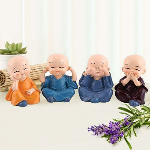 Attractive Set of 4 Buddha Monks Figurines