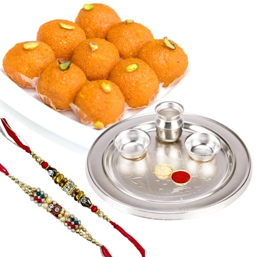Pride-to-Possess Silver Plated Thali with Haldiram Ghee Ladoo & 2 Designer Rakhi and Roli Tilak Chawal