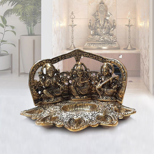 Buy Metallic Diya with Ganesh, Lakshmi N Saraswati Idol