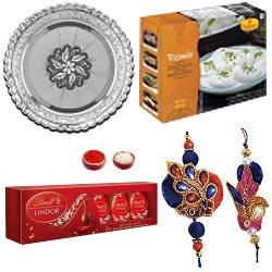 Charming Rakhi Combo With Haldiram Rasmalai , Lindor Chocolate And Silver Puja Thali