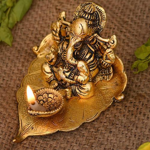 Lovely Ganesh on Leaf with Diya for Spiritual Mummy