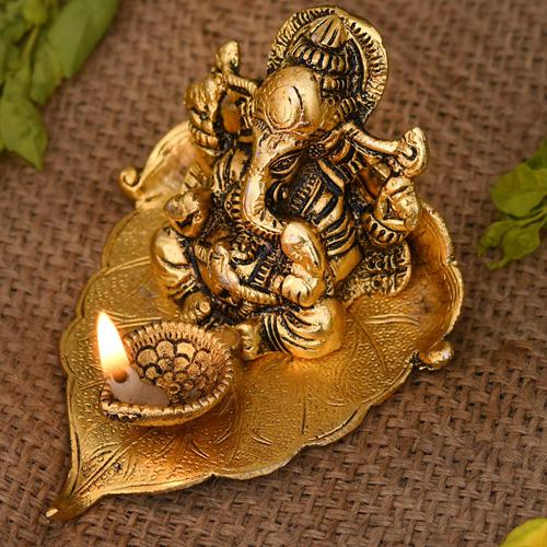 Marvelous Ganesha on Leaf with Diya