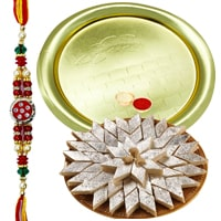 Send Delicious Haldiram Kaju Katli  with  Golden Plated Thali and Free Rakhi, Roli, Tilak and Chawal to Kerala