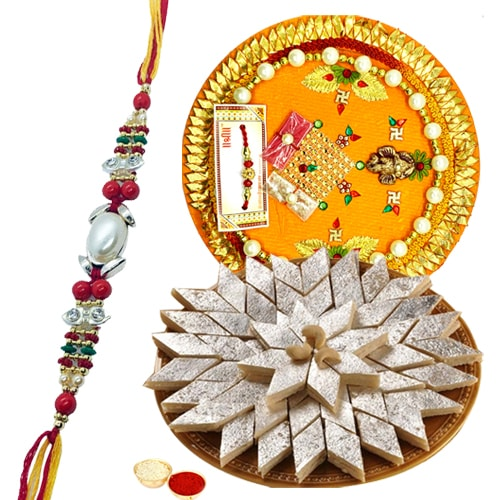 Delicious Kaju Katli and Designer Pooja Thali along Rakhi, Roli, Tilak and Chawal
