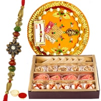 Send Assorted Sweets from Haldiram and Rakhi Thali along Rakhi, Roli, Tilak and Chawal to Kerala
