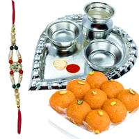 Send Laddoo from Haldiram and Stylish and Trendy looking Silver Plated Paan Shaped Puja Aarti Thali (weight 52 gms) along Rakhi, Roli, Tilak and Chawal to Kerala