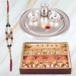 Send Assorted Sweets from Haldiram and Stylish and Trendy looking Silver Plated Paan Shaped Puja Aarti Thali (weight 52 gms) along Rakhi, Roli, Tilak and Chawal to Kerala