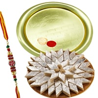 Send Kaju Katli from Haldiram and Gold Plated Puja Thali along Rakhi, Roli, Tilak and Chawal to Kerala