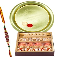 Send Assorted Sweets from Haldiram and Gold Plated Puja Thali along Rakhi, Roli, Tilak and Chawal to Kerala