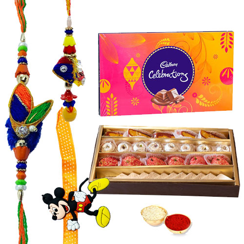 Breathtaking Gift of Chocolacious Cadbury Celebration Pack and Appetizing Sweets made by <font color=#FF0000>Haldiram</font>s