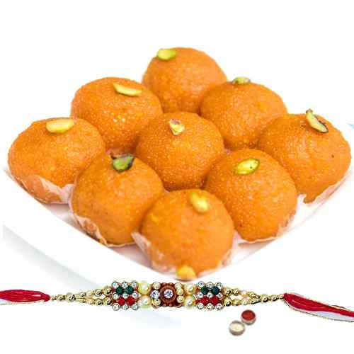 A Free Decorative Rakhi, Roli Tilak and Chawal with Haldiram Pure Ghee Ladoo