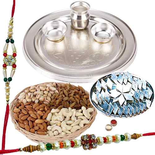 An amazing Silver plated Thali, Haldiram Kaju Katli, Dry Fruits with free Rakhi, Roli Tilak and Chawal