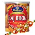Beautifying Om Rakhi with 1 Kg. Haldirams Rajbhog Pack