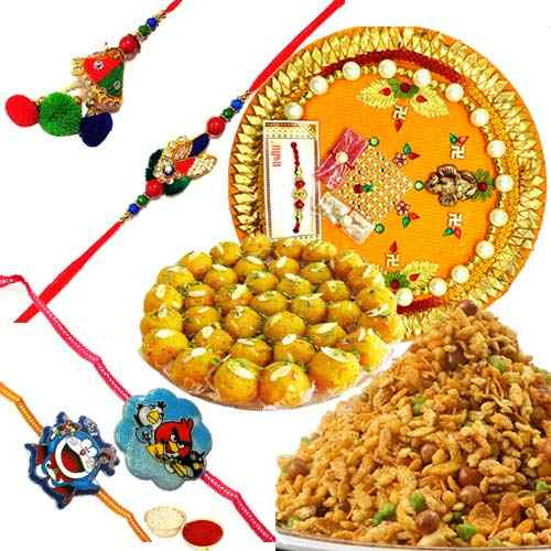 Ecstatic Combo of Boondi Ladoo, Masala Peanuts, Rakhi Thali, 1 Bhaiya Bhabhi Rakhi Set and 2 Kids Rakhi