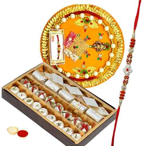 Flattering Selection of One Assorted Mithai Pack, One Rakhi Thali and One Fancy Rakhi