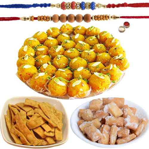 Exquisite Rakhi Special Goodies Hamper of Sakar Para, Namak Para N Boondi Laddoo with Two Rakhi