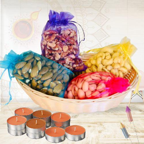 Delectable Dry Fruits Potli with Candles N Laxmi Ganesh Idol