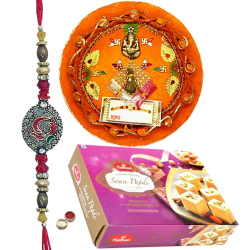 Attractive Rakhi with Thali and Haldirams Soan Papdi 250 Gms.<br /><font color=#0000FF>Free Delivery in USA</font>