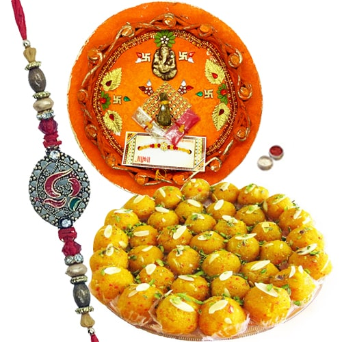 Charming Bracelet of Rakhis with Thali and Melted Sweets<br /><font color=#0000FF>Free Delivery in USA</font>