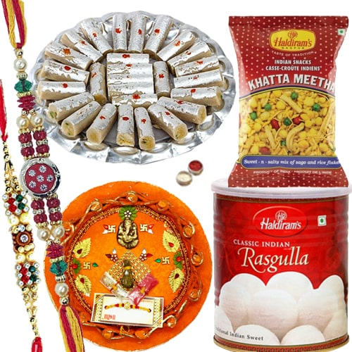 Rakhi Thali with Rakhis, Haldirams Rasgulla, Kaju Pista Roll n Chanachur<br><font color=#0000FF>Free Delivery in USA</font>