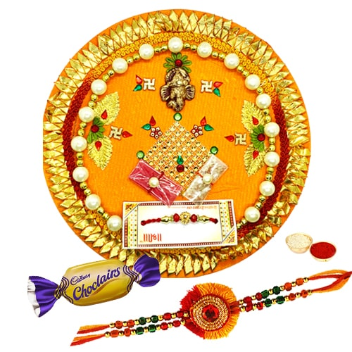 Lucky Rakhi and Thali with Chocolates Charm<br /><font color=#0000FF>Free Delivery in USA</font>