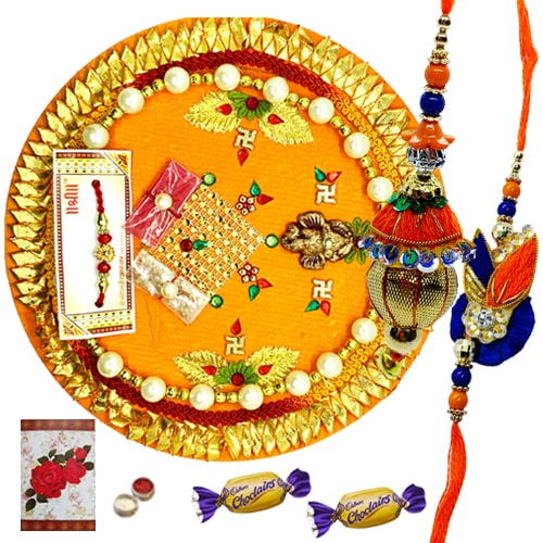 Ravishing Thali with Inviolable Bond of Bhaiya Bhabhi Rakhi and 2 Chocolates<br /><font color=#0000FF>Free Delivery in USA</font>