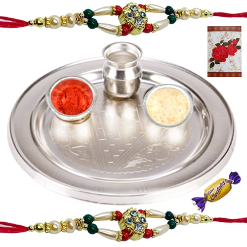 Wonderful 2 Rakhis with Silver Thali and Chocolates<br /><font color=#0000FF>Free Delivery in USA</font>