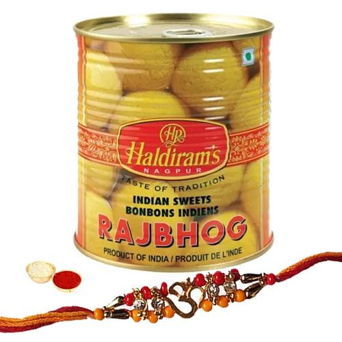One or More Designer Ethnic Rakhi with 1 Kg. Haldirams Rajbhog Pack<br /><font color=#0000FF>Free Delivery in USA</font>