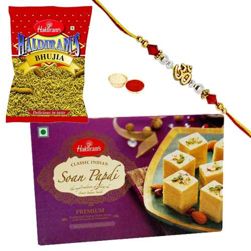 Delectable Haldirams Sweet Delight with Rakhi<br /><font color=#0000FF>Free Delivery in USA</font>