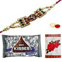 Auspicious Om/Ganesh Rakhi, Kisses Chocolate Pack of 3 Oz. from Hersheys and a Free Message Card<br /><font color=#0000FF>Free Delivery in USA</font>