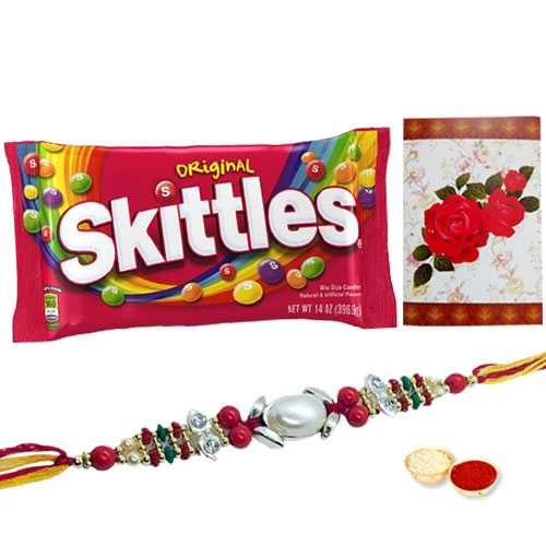 Pious Ganesh/Om Rakhi, 3 Oz. Skittles Chocolate Pack and a Free Message Card<br /><font color=#0000FF>Free Delivery in USA</font>