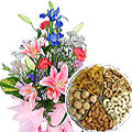 Send Radiant Seasonal Flowers with Dry Fruits to Kerala